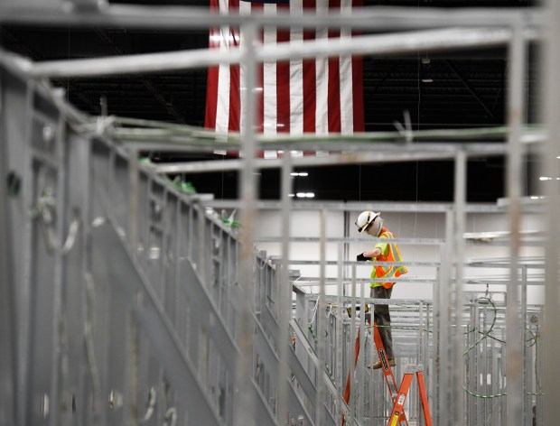 A construction worker works on a ...