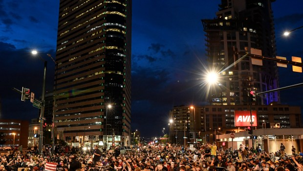 Protesters sit on Broadway after making ...