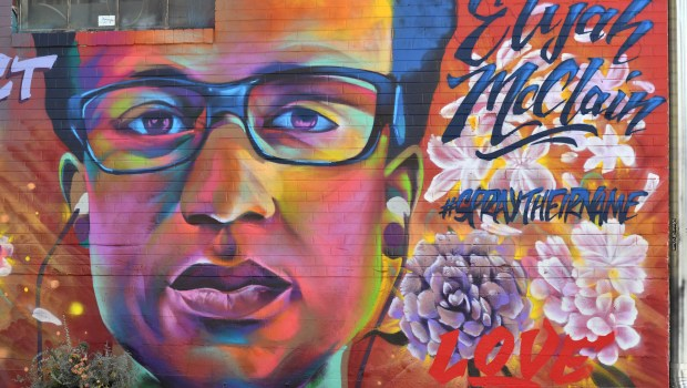 A mural of Elijah McClain, painted ...