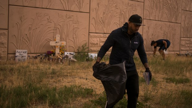 Terrance Roberts picks up trash around ...