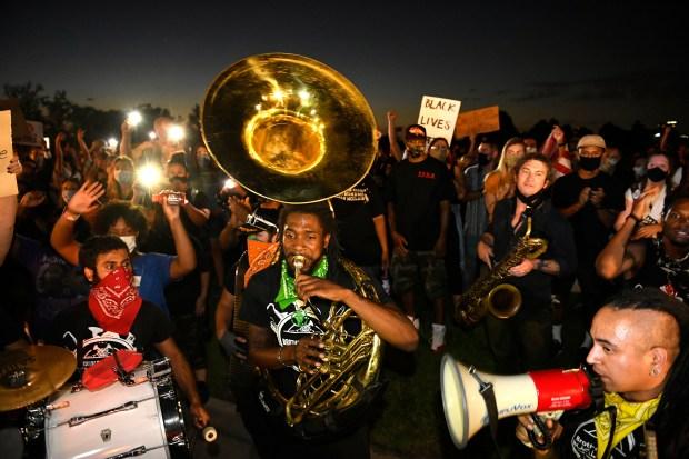 Khalil Simon, center, plays the sousaphone ...