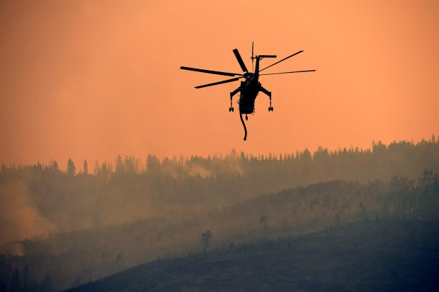A Sikorsky Skycrane heads out to ...