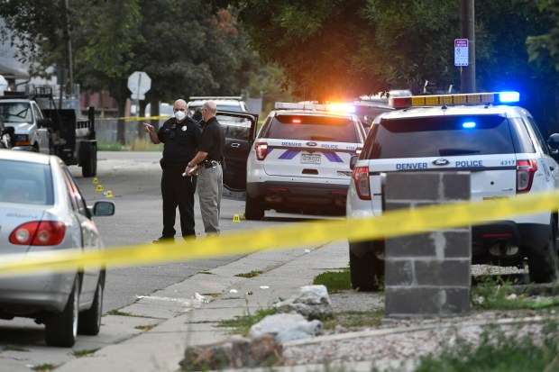 Denver police investigate the scene of ...