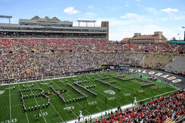 The Colorado Buffaloes marching band performs ...