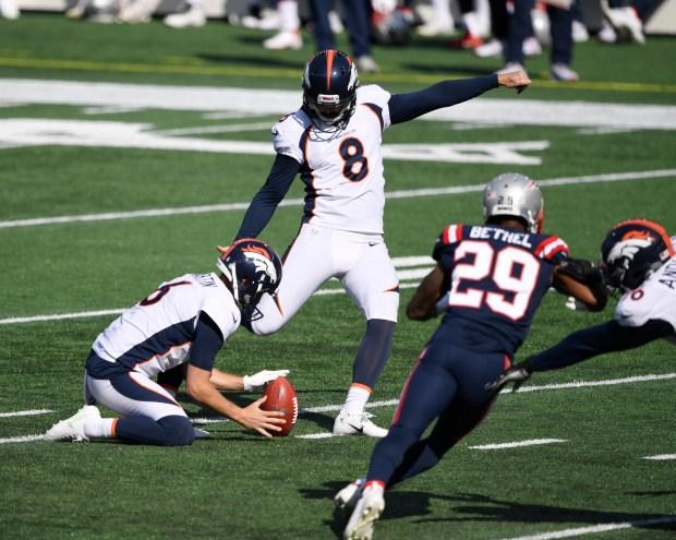 Denver Broncos kicker Brandon McManus (8) ...