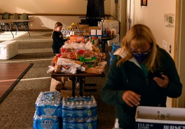 Berkeley Hughes, 7, left, grabs snacks ...