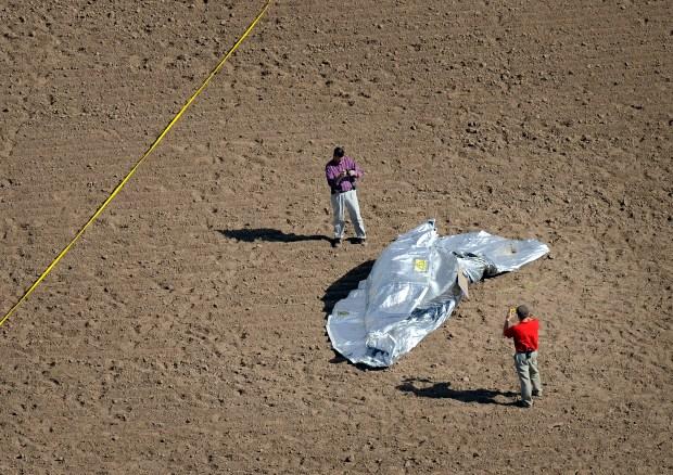 Investigators photograph the ballon in a ...