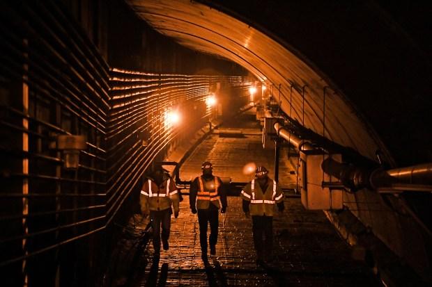Neal Retzer, tunnel resident engineer, left, ...