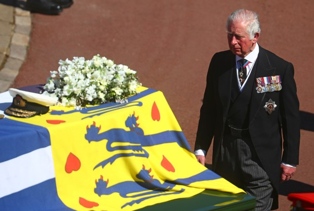 Prince Charles follows the coffin of ...