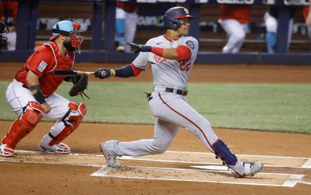 Washington Nationals' Juan Soto (22) doubles ...
