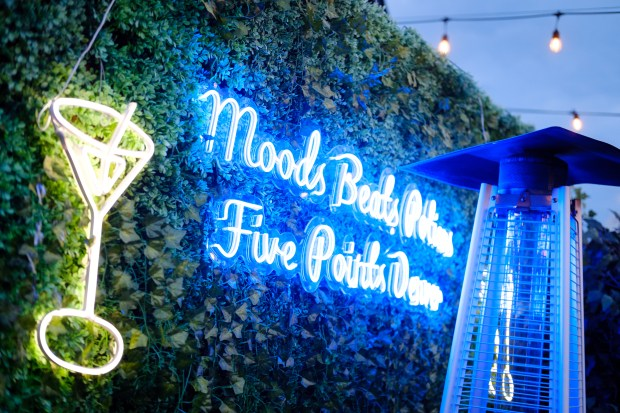 A neon sign glows at Moods. ...