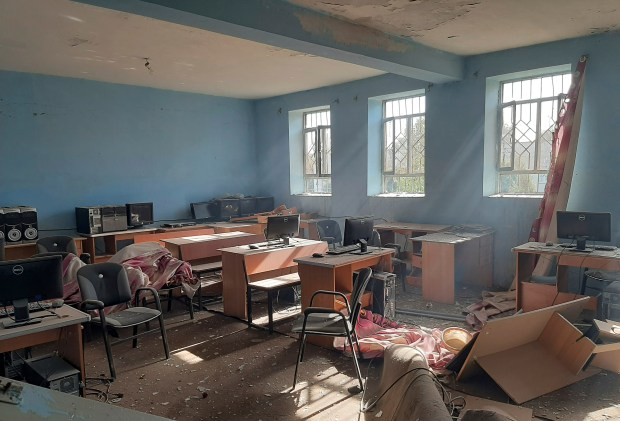 A damaged school is seen after ...