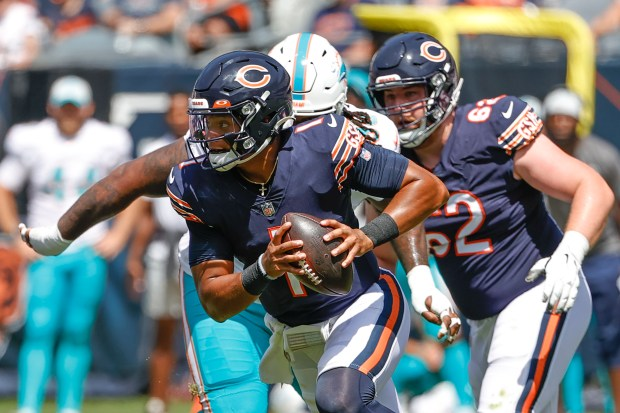 Chicago Bears quarterback Justin Fields (1) ...