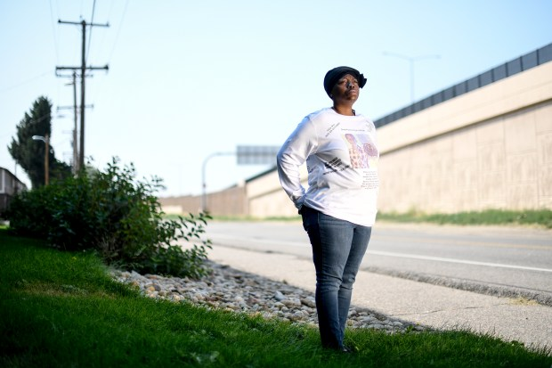 Sheneen McClain stands at the site ...