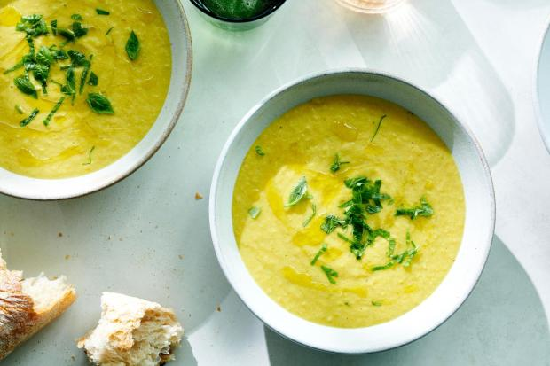 Creamy corn soup with basil in ...