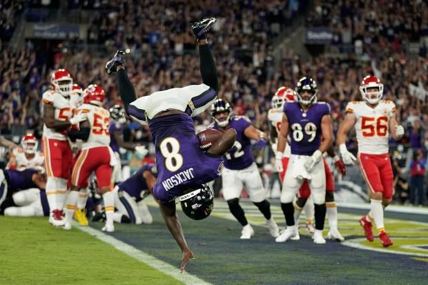 Baltimore Ravens quarterback Lamar Jackson scores...