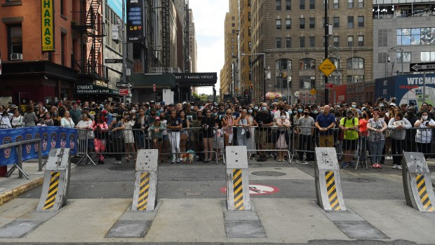 Everyday New Yorkers and visitors wait ...