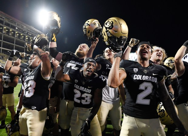 The Colorado Buffaloes celebrate their victory...