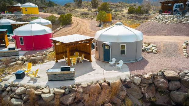 Brightly colored yurts offer privacy at Royal Gorge Riverside near Canon City. Each comes with a covered sitting area, grill and firepit and chairs.