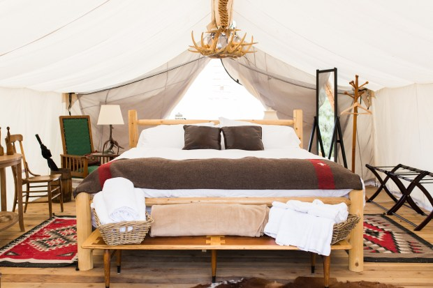 The luxury tents at the Vail Collective feature large beds with thick mattresses and quality sheets and blankets, a sitting area, lighting, wooden floors and other comforts - and a touch of the wildness of camping.