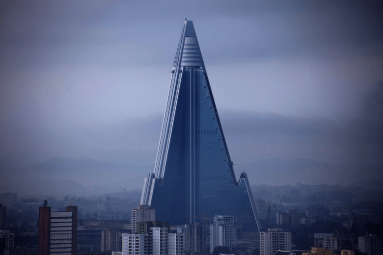 The Ryugyong Hotel looms over Pyongyang, North Korea. The 105-story building has been under construction since 1987, and is considered the world's tallest unfinished building. Image by Roman Harak, used with a Creative Commons license.