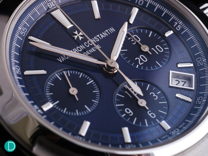 Dial detail showing the play of light on the blue laquer over the dial elements.