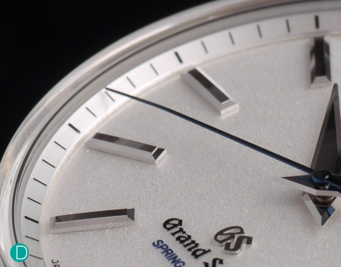 The seconds hand is long and elegant, and is hand rolled so that it is closer to the dial at its end to reduce parallax error.