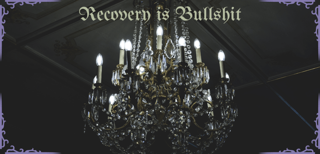 Crystal chandelier with the words Recovery is Bullshit written on it
