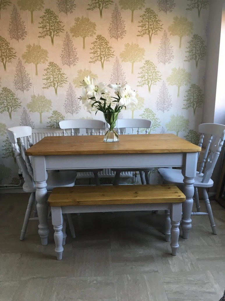 Small grey dining table made from reclaimed wood with bench