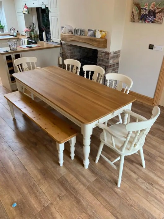 Restored dining room table with white legs and wooden table top