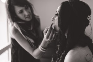 The bride has lipstick applied before her Bowral wedding