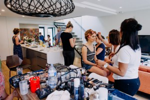 Bridesmaids get prepared for wedding ceremony at home in Bondi