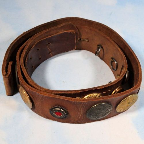 "BELT - ""HATE BELT"" ASSEMBLED BY AMERICAN SOLDIER - FEATURES TWENTY-FOUR DIFFERENT BUTTONS, INCLUDING A KOKARDE AND OFFICER'S PIPS"