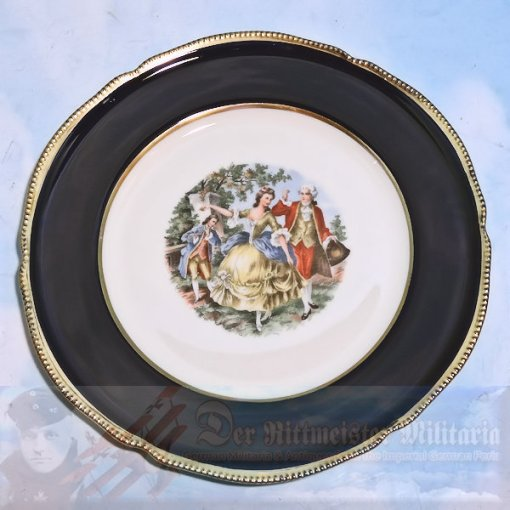 white plate - Cobalt blue rim - gold trimmed - 3 dishes 10 3/4 inch diameter - painted print in center - Victorian era image of woman and gentleman outside dancing while another gentleman is playing the piccolo. The plate is decorative with some beveling on the rim along with raised edge.