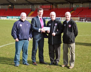 Monthly Draw Committee handing over a cheque for £7,000 to the club.  L-R: Richard McKinney, Roddy Collins, George Caldwell, and Pat Gillen