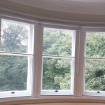 secondary glazing supplier in ireland Vertical balanced sliding Secondary glazing window made to measure in ireland custom made glass installed by glaziers in ireland