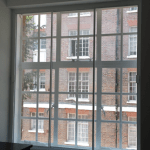 Sliding sash traditional window restoration with vertical balanced opening secondary glazing improve heat insulation meets building regulations dublin ireland