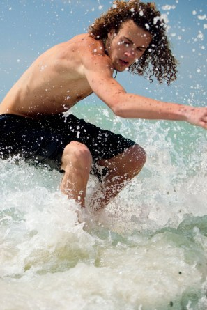 Courtesy of Visit St. Pete Clearwater - Teen Boy (skimboarding)
