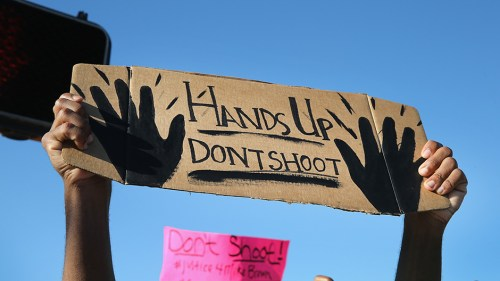 protest-sign-over-ferguson-shooting-don-t-shoot