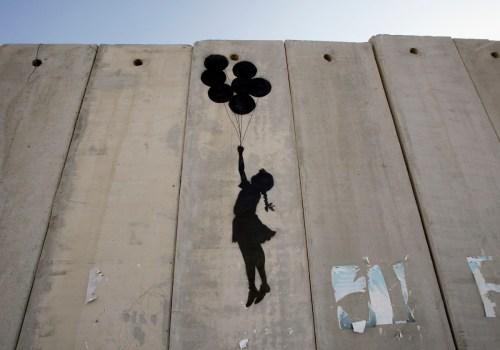 British Guerrilla Artist Decorates West Bank Barrier