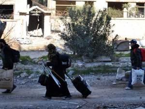Civiles sirios huyen de la zona de conflicto