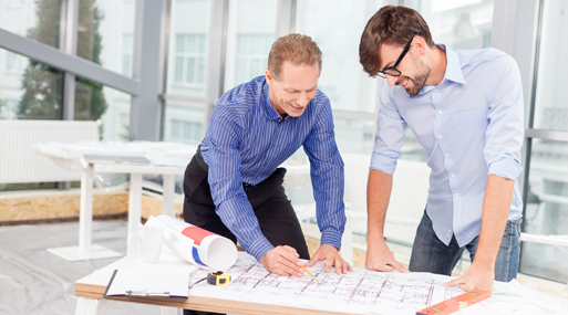 Professional male engineers are discussing new project