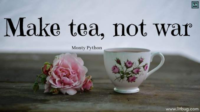 "Text at the top of the image reads ""Make tea, not war Monty Python"" underneath the text on a weathered wood table is an open pink rose with a bud to either side, and a tea cup with pink roses painted on it."