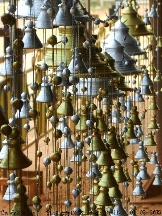 Earthern Wind Chimes - displayed for sale at a craft mela in Bengaluru