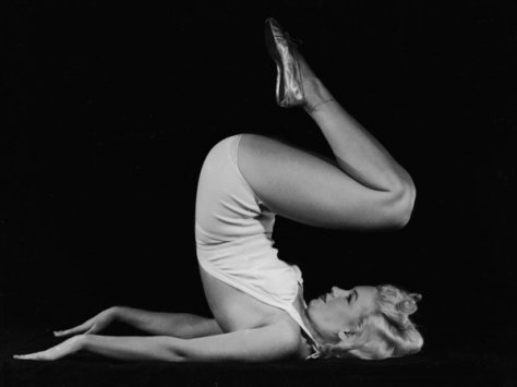 1948: American film star Marilyn Monroe (1926 - 1962) raises her legs in the air and assumes a yogic exercise position. (Photo via John Kobal Foundation/Getty Images)