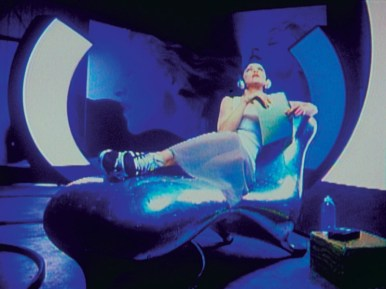 MADONNA (from 'Rain' Video Clip, 1993) on LOCKHEED LOUNGE Chaise Longue-Lounger-Daybed by Marc Newson (1986-1988) - Copyright: © Marc Newson, MTV, Maverick/Sire/Warner Bros Records
