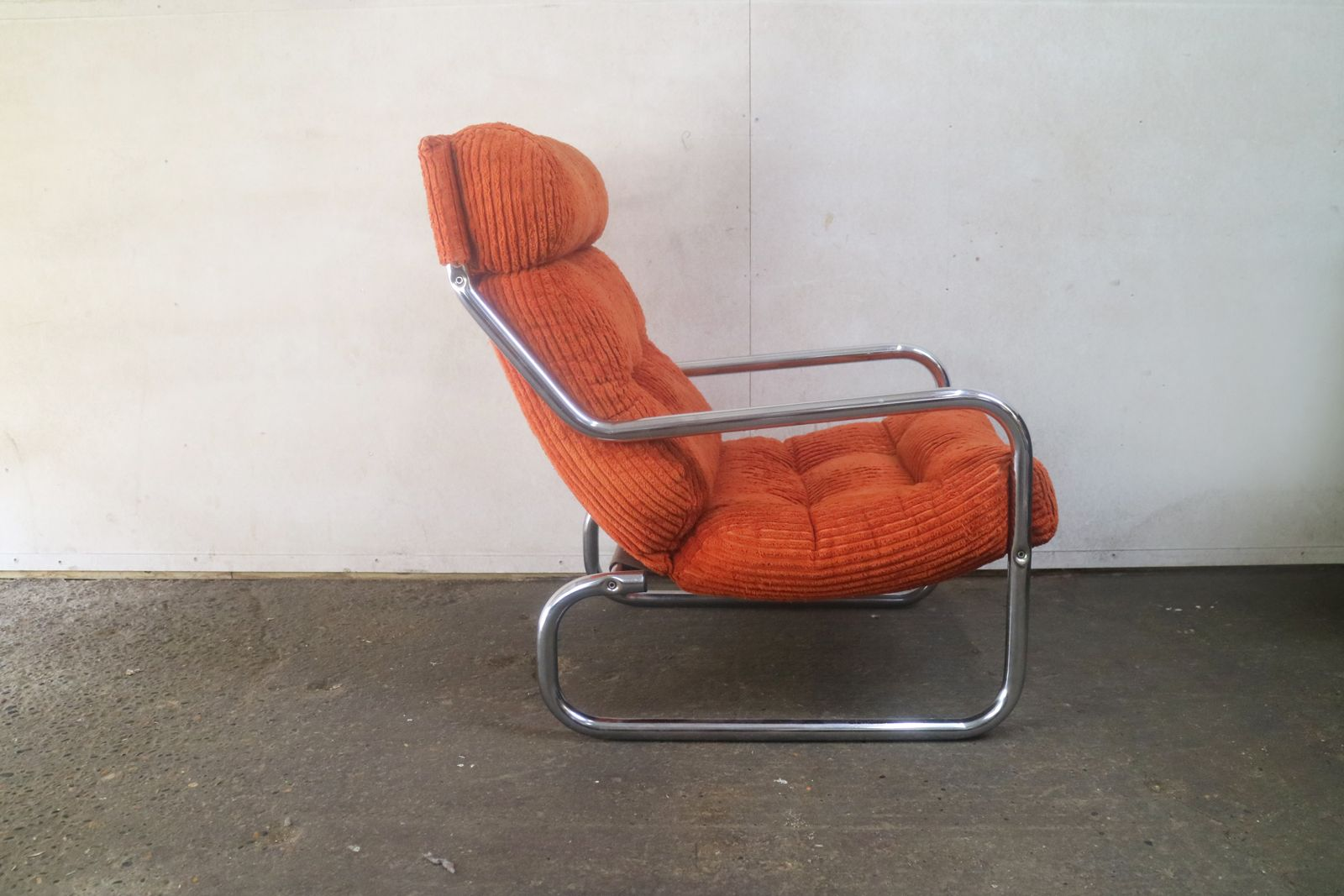 German vintage orange lounge chair  Design Market