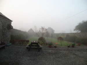 The formal back garden in the morning mist at The Harbour Masters House, Shannon Harbour, County Offaly