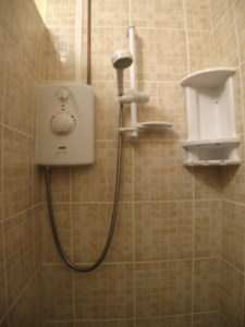 Electric shower heats the water in the shower as you need it.