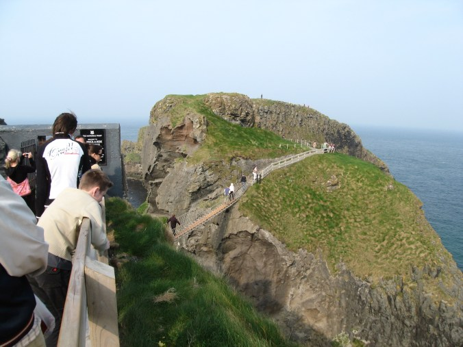 Carrick-a-Rede Rope Bridge is a white-knuckle crossing, a windy rope bridge from sheer cliffs over a deep chasm to an island that rises sheerly out of a turbulent sea.